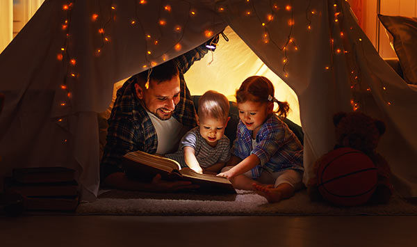 Family reading good night stories